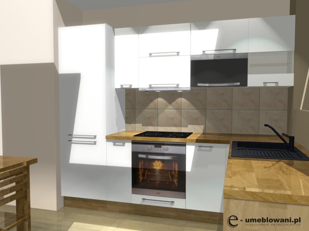 Aranżacja małej białej kuchni z blatem drewnianym
