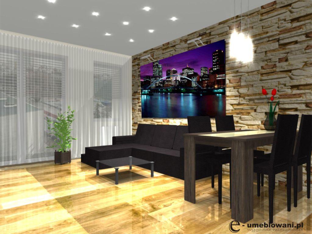 Stół w salonie, klinkier na ścianie, kanapa narożna, stolik kawowy szklany
