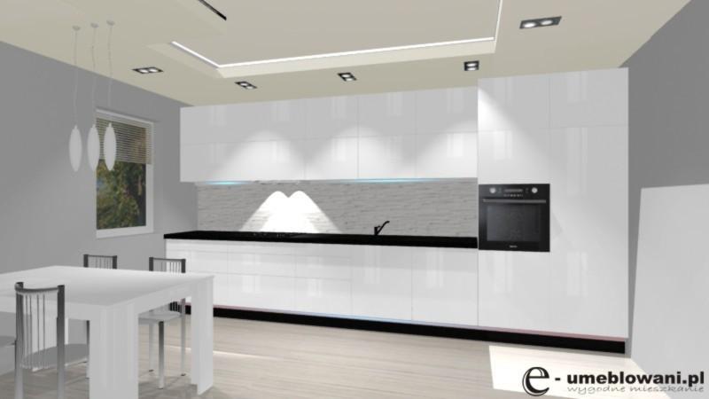 kuchnia otwarta, nowoczesna biała, klinkier, czarny blat, szara podłoga
