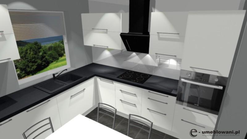 Biała kuchnia z czarny blatem, stół, zlew pod oknem, kuchnia w L