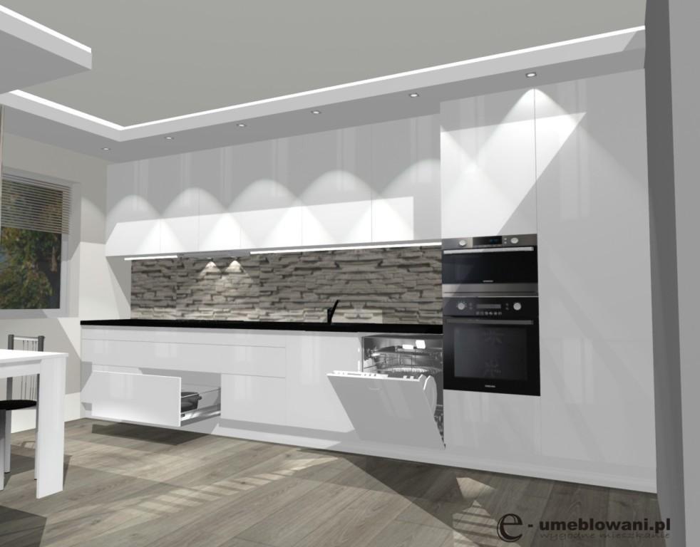 Kuchnia otwarta na salon, szuflady blum na garnki, talerze, sztućce, klinkier na ścianie, panele egger