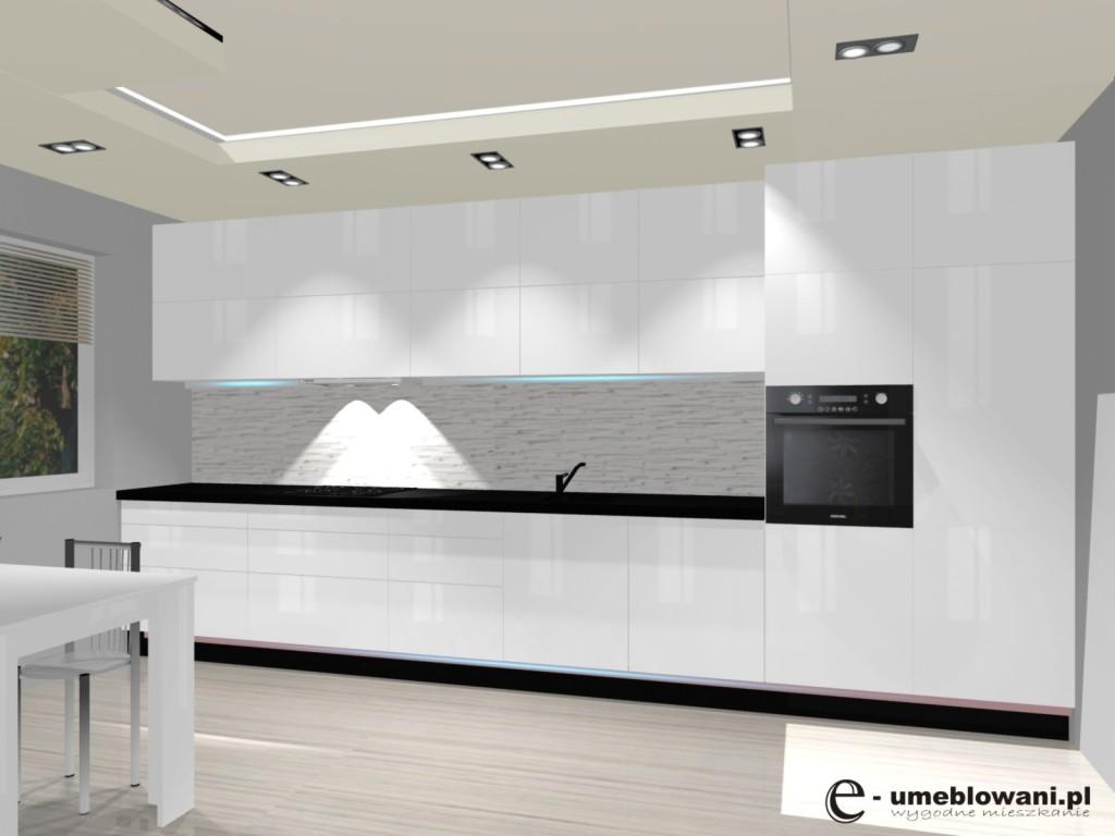 biała kuchnia, bez uchwytów, czarny blat, oświetlenie pod szafkami, klinkier w kuchni