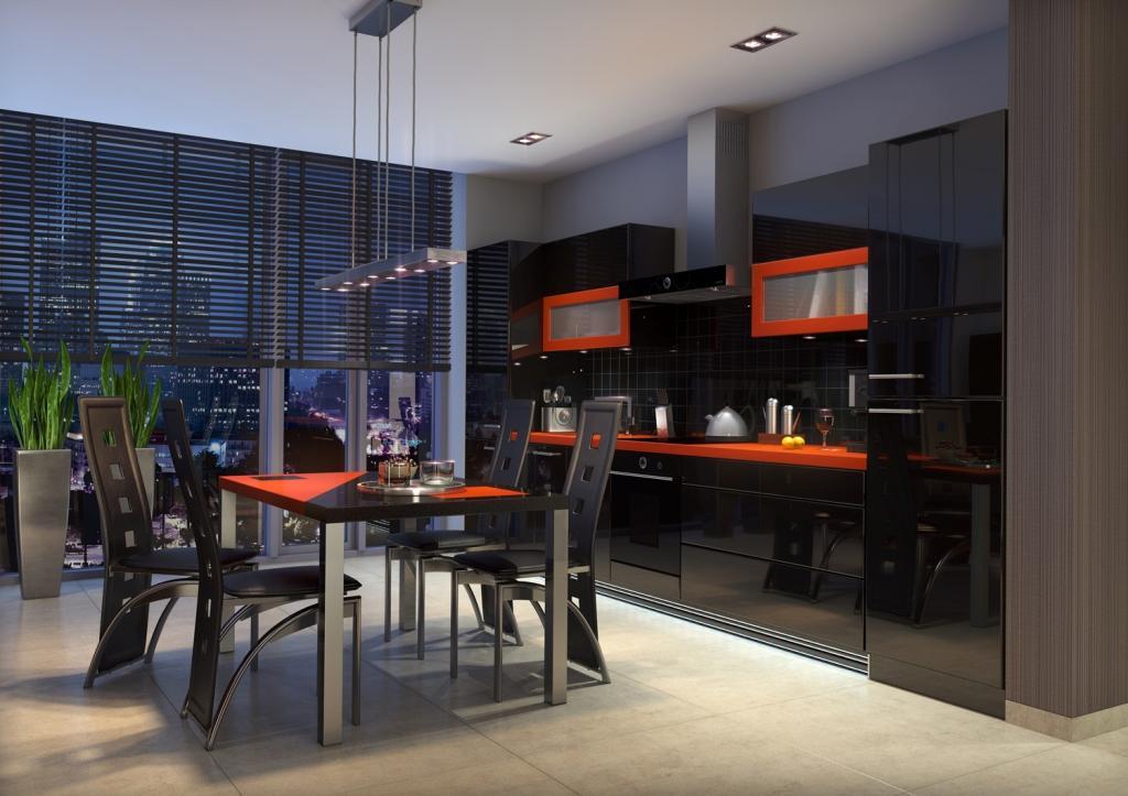 Otwarta kuchnia czarna, pomarańczowa, jadalnia, stół czarny, krzesła czarne, płytki beton